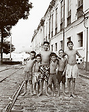 Brazil, Belem, South America, portrait group of happy shirtless boys standing together, one with soccer ball