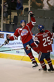 March 15, 2009:  Center David Brine (34) of the Rochester Amerks, AHL affiliate of Florida Panthers, celebrates a goal with Jordan Henry (25) during the third period of a regular season game at the Blue Cross Arena in Rochester, NY.  Hamilton defeated Rochester 4-3 in a shoot out.  Photo Copyright Mike Janes Photography 2009