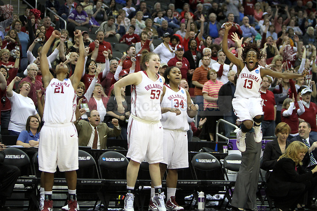 Oklahoma's Bench celebrates as the last few seconds tick away in Tuesdays win against UK in the NCAA Women's Basketball Kansas City Regional Finals at the Sprint Center. Photo by Brandon Goodwin | Staff