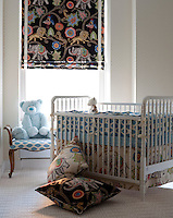 The baby's bedroom benefits from a smart designer blind in a fun pattern