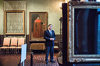 "Anthony Amore is the Directory of Security and Chief Investigator at the Isabella Stewart Gardner Museum in Boston, Mass., USA, seen here in The Dutch Room at the museum on Tues., Dec. 5, 2017. Part of Amore's ongoing work is the investigation into the 1990 theft of 13 pieces from the museum: 10 paintings, 2 objects, and 1 etching. Among the paintings stolen were works by Rembrandt, Vermeer, Degas, and Manet. The large empty frame on the wall is what held Rembrandt's ""The Storm on the Sea of Galilee"" painting until it was stolen from the museum in the heist. At right is another empty frame, which held Vermeer's ""The Concert"" until it, too, was stolen."