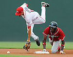 Jiwan James (23) of Lakewood BlueClaws slides safely into second base as Derrik Gibson (18) of the Greenville Drive stumbles as he tries to get the ball in a game on Aug. 2, 2010, at Fluor Field at the West End in Greenville, S.C. The Drive lost to the BlueClaws, 5-1. Photo by: Tom Priddy/Four Seam Images