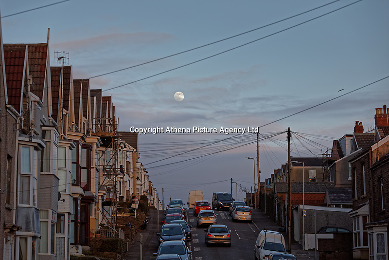 Pictured: The moon rises over terraced houses in Cromwell Street, Swansea, Wales, UK. Monday 18 February 2019<br /> Re: February's full moon will be the biggest supermoon of 2019.<br /> The supermoon occurs during this full moon because it will be closest to Earth. The supermoon will reach its peak on Tuesday morning but won't be visible.