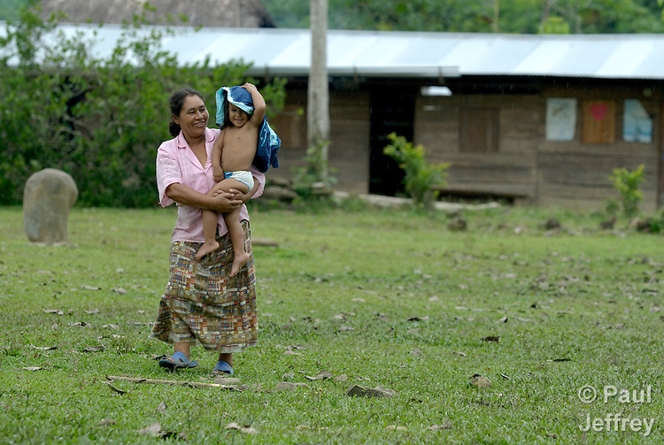 A woman and her daughter walking through the peace community of San Jose de Apartado, Colombia.  In 1997, 1400 war-weary peasants declared they would no longer cooperate with any of the armed parties in the hemisphere's longest-running war. They paid a heavy price for their witness; more than 200 members of the community have been killed. In 2013, two army generals were indicted for a 2005 massacre in the community, and on December 10, 2013, Colombian President Juan Manuel Santos Calderon, in the name of the state, publicly asked the community for forgiveness.