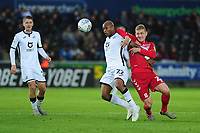Andre Ayew of Swansea City under pressure from George Saville of Middlesbrough during the Sky Bet Championship match between Swansea City and Middlesbrough at the Liberty Stadium in Swansea, Wales, UK. Saturday 14 December 2019