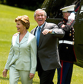 United States President George W. Bush and first lady Laura Bush return to the White House in Washington, D.C. aboard Marine 1 after spending the week-end at Camp David, the Presidential retreat near Thurmont, Maryland on May 29, 2005.<br /> Credit: Ron Sachs - Pool