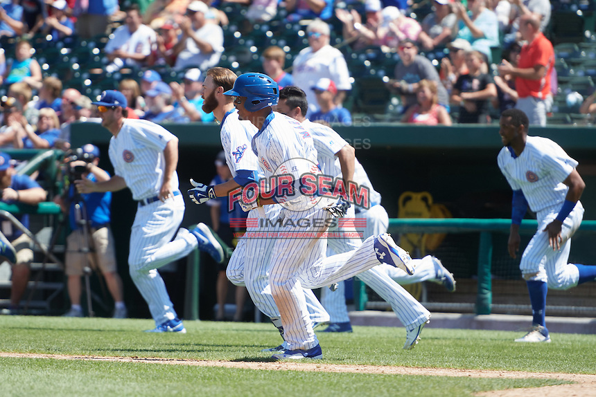 South Bend Cubs right fielder Eddy Martinez (15) and teammates rush the field to celebrate a walk off victory during the first game of a doubleheader against the Peoria Chiefs on July 25, 2016 at Four Winds Field in South Bend, Indiana.  South Bend defeated Peoria 9-8.  (Mike Janes/Four Seam Images)