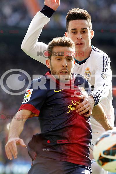 Real Madrid's Jose Maria Callejon (r) and FC Barcelona's Jordi Alba during La Liga match.March 02,2013. (ALTERPHOTOS/Acero) /NortePhoto