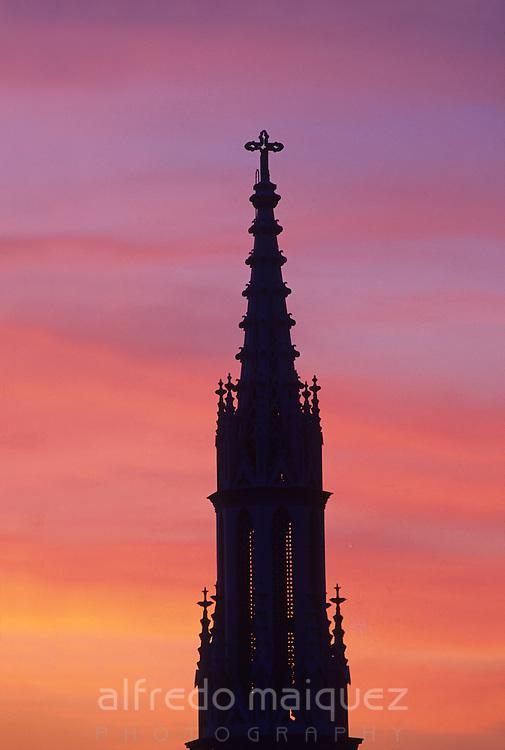 Top of El Carmen church bell tower at sunset.   Bella Vista, Panama City, Panama, Central America.