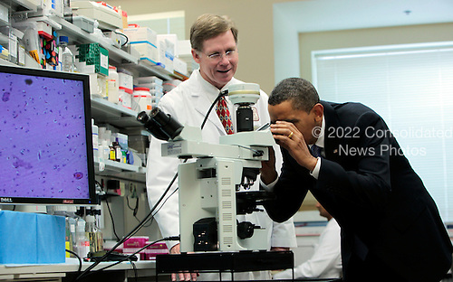 Bethesda, MD - September 30, 2009 -- United States President Barack Obama looks at brain cells in a microscope during a tour of a laboratory with Health & Human Services Secretary Kathleen Sebelius at the National Institutes of Health (NIH), Bethesda, Maryland, Wednesday, September 30, 2009. After the visit, President Obama will make a major announcement regarding the American Recovery and Reinvestment Act  at the National Institutes of Health..Credit: Aude Guerrucci / Pool via CNP