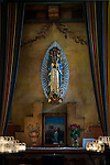 Mission San Juan Bautista, altar and shrine to Nuestra Señora de Guadalupe; candles