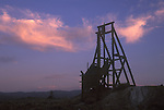 Gold mine headframe at sundown, Goldfield, Nev.
