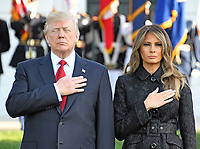 United States President Donald J. Trump and first lady Melania Trump place their hands over their hearts as a bugler blows &quot;Taps&quot; as they lead a moment of silence in remembrance of those lost on September 11, 2001 on the South Lawn of the White House in Washington, DC on Monday, September 11, 2017.<br /> CAP/MPI/CNP/RS<br /> &copy;RS/CNP/MPI/Capital Pictures