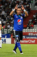 MANIZALES - COLOMBIA -01-04-2015: Fernando Uribe, jugador Millonarios celebra el gol anotado al Once Caldas durante partido aplazado entre Once Caldas Millonarios por la fecha 3 por de la Liga Aguila I 2015, jugado en el estadio Palogrande de la ciudad de Manizales.  / Fernando Uribe, player of Millonarios celebrates a scored goal to Once Caldas during a postponed match betwen Once Caldas and Millonarios for the date Millonarios for the Liga Aguila I 2015 at the Palogrande stadium in Manizales city. Photo: VizzorImage / Santiago Osorio / Str.
