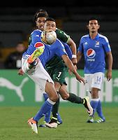 BOGOTA - COLOMBIA -15 -05-2016: Santiago Trellez (Izq.) jugador de La Equidad disputa el balón con David Silva (Der.) jugador de Millonarios, durante partido entre La Equidad y Millonarios, por la fecha 18 de la Liga Aguila I-2016, jugado en el estadio Nemesio Camacho El Campin de la ciudad de Bogota. / Santiago Trellez (L) player of La Equidad vies for the ball with David Silva (R) player of Millonarios, during a match La Equidad and Millonarios, for the  date 18 of the Liga Aguila I-2016 at the Nemesio Camacho El Campin Stadium in Bogota city, Photo: VizzorImage  / Luis Ramirez / Staff.