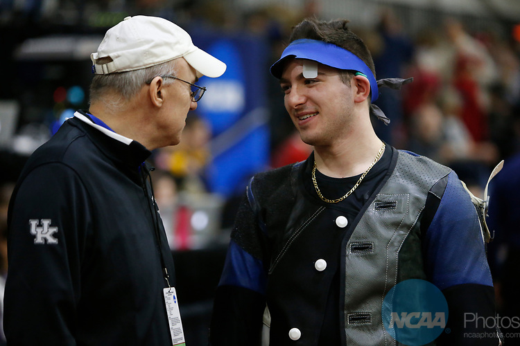 COLUMBUS, OH - MARCH 11: Billy Azzinaro of the University of Kentucky speaks with head coach Harry Mullins during the Division I Rifle Championships held at The French Field House on the Ohio State University campus on March 11, 2017 in Columbus, Ohio. (Photo by Jay LaPrete/NCAA Photos via Getty Images)