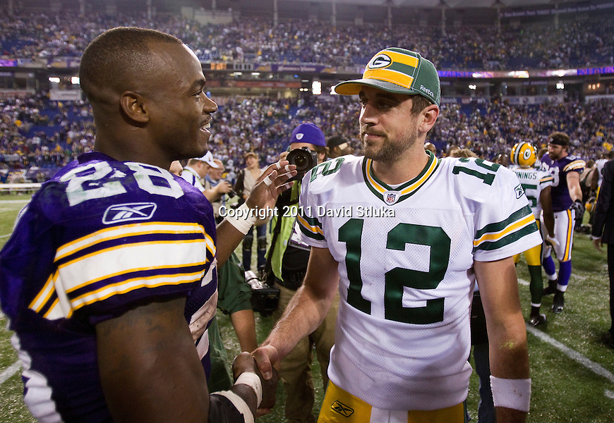 Minnesota Vikings running back Adrian Peterson (28) and Green Bay Packers quarterback Aaron Rodgers (12) shake hands at midfield after a Week 7 NFL football game on October 23, 2011 in Minneapolis, Minnesota. The Packers won 33-27. (AP Photo/David Stluka)