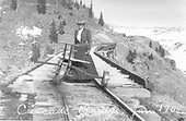 Lady on Cascade Creek Trestle with 3-wheel speeder.  Hand pumped.<br /> D&amp;RG  Osier, CO  Taken by Lively, Charles R. - 1/1908
