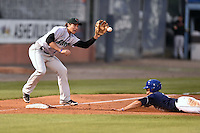 Augusta GreenJackets third baseman Jonah Arenado (20) fields the ball and applies the tag as Josh Fuentes (21) slides in safely during a game against the Asheville Tourists on April 28, 2015 in Asheville, North Carolina. The Tourists defeated the GreenJackets 7-3. (Tony Farlow/Four Seam Images)