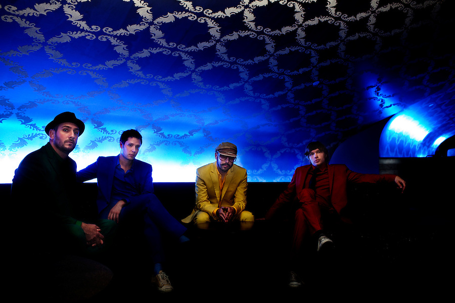 "Los Angeles, California, November 27, 2010 - A portrait of the band Ok Go, from left, drummer, Dan Konopka (green), lead singer/guitarist, Damian Kulash (blue), bass guitarist/singer, Tim Nordwind (yellow), and guitarist/singer, Andy Ross (red), in the VIP lounge at the Nokia Club. OK Go was wrapping up a 16-month world tour by playing a song for Yo Gabba Gabba! during the day and later a final show at the Nokia Club. The Grammy Award-winning band has earned considerable fame for their creative, often low-budget music videos that are released on YouTube. Many have gone viral, including the 2006 video for ""Here It Goes Again"", where the band performs a complex routine on treadmills. It has received over 50 million views to date. Kulash says the band left their major label and began their own to assert more creative control over their music and their videos. Adding, ""We're among the first musicians to view our YouTube videos as standalone artistic output, not advertisement for our recordings, and it shows in the numbers: over the past decade, we've sold a little over 600,000 records globally, and our videos have combined views in excess of 125 million.""."