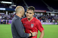ORLANDO, FL - NOVEMBER 15: USMNT coach Gregg Berhalter chats with Aaron Long #3 as he steps off the field during a game between Canada and USMNT at Exploria Stadium on November 15, 2019 in Orlando, Florida.
