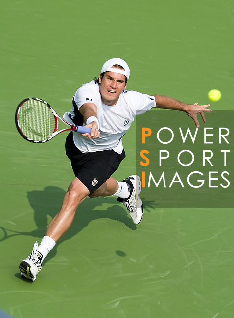 SHANGHAI, CHINA - OCTOBER 13:  Tommy Haas of Germany retuns a shot to compatriot Benjamin Becker during day three of 2009 Shanghai ATP Masters 1000 at the Qi Zhong Tennis Centre in Shanghai. Photo by Victor Fraile / The Power of Sport Images