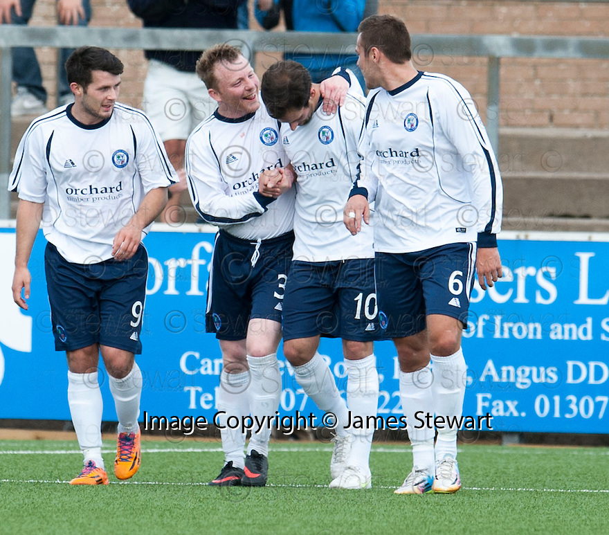 Forfar's Gavin Swankie (10) is congratulated after he scores their third goal.