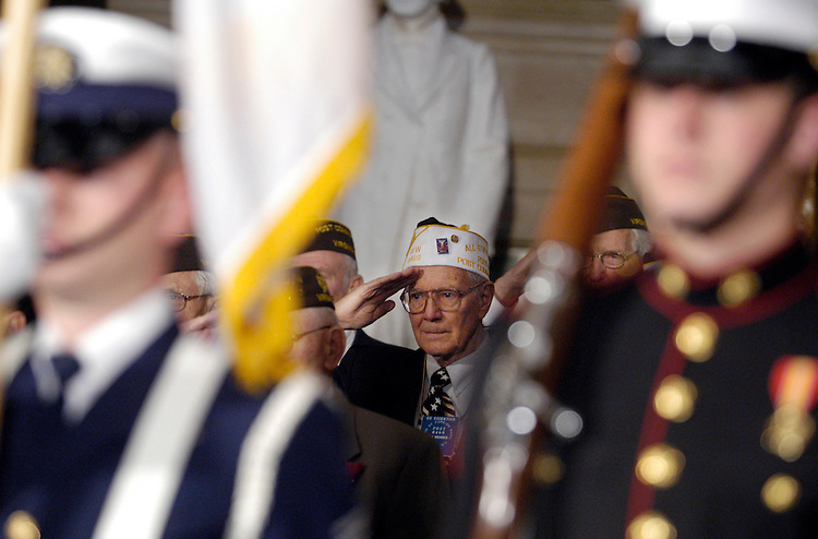 WWII veteran Ed Essertier, VFW Post 8469, salutes during the Color Guard. The House Bipartisan leadership honored all World War II veterans that served in the House Representatives today, presenting them with a flag that was flown over all the major WWII cemeteries across the world.