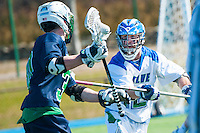 Ross Burr,'16, right, works defense as the Seahawks battle Endicott in Men's Lacrosse game action at Gaudet Field in Middletown.