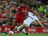 24th February 2020; Anfield, Liverpool, Merseyside, England; English Premier League Football, Liverpool versus West Ham United; Georginio Wijnaldum of Liverpool  is tackled by Mark Noble of West Ham United
