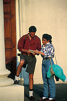 Tourist couple cinsulting a city map, Charleston, South Carolina
