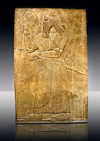 Assyrian relief sculpture panel  of King Ashurnaspiral II with his sword and a staff. The panel is possibly from his private apartments..  From Nimrud, Iraq,  865-860 B.C North West Palace. Room S, panel 3.  British Museum Assyrian  Archaeological exhibit no WA 124563.