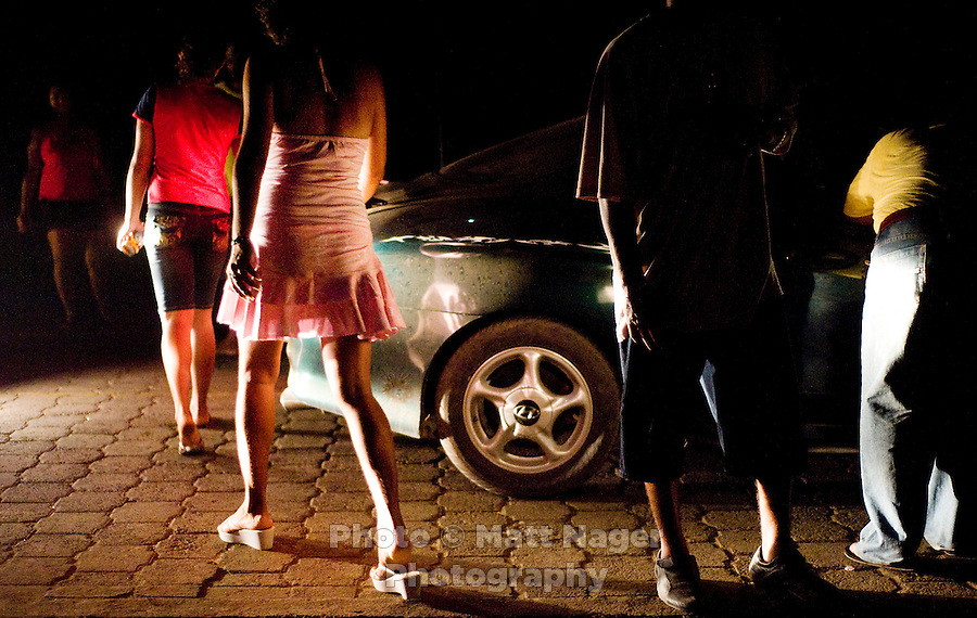 Girls walk past a group of guys outside the popular dance hall at Club Nica on Big Corn Island of the coast of Nicaragua in April 2009.