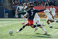FOXBOROUGH, MA - MARCH 7: Gustavo Bou #7 of New England Revolution takes a shot at goal during a game between Chicago Fire and New England Revolution at Gillette Stadium on March 7, 2020 in Foxborough, Massachusetts.