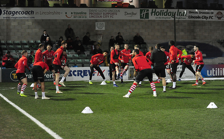 Lincoln City players during the pre-match warm-up<br /> <br /> Photographer Andrew Vaughan/CameraSport<br /> <br /> The EFL Sky Bet League Two - Lincoln City v Exeter City - Tuesday 26th February 2019 - Sincil Bank - Lincoln<br /> <br /> World Copyright © 2019 CameraSport. All rights reserved. 43 Linden Ave. Countesthorpe. Leicester. England. LE8 5PG - Tel: +44 (0) 116 277 4147 - admin@camerasport.com - www.camerasport.com