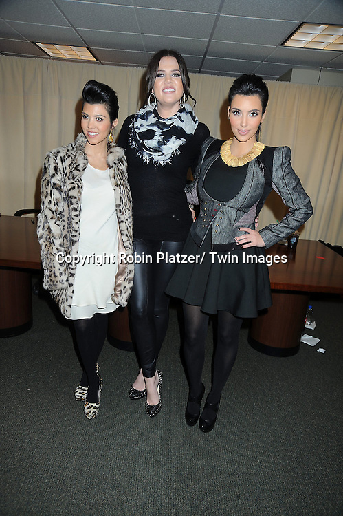 """Kourtney, Khloe and Kim Kardashian at a book signing for """"Kardashian Konfidential""""  at Barnes & Noble on 5th Avenue in New York City on.November 30, 2010."""
