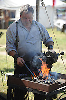 NWA Democrat-Gazette/ANDY SHUPE<br /> A blacksmith works to make a tent stake Saturday, Sept. 26, 2015, during a re-enactment of the Civil War Battle of Pea Ridge in Pea Ridge. Visit nwadg.com/photos to see more from the weekend.