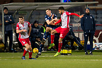 30th November 2019; Dens Park, Dundee, Scotland; Scottish Championship Football, Dundee Football Club versus Queen of the South; Darren Lyon and Faissal El Bakhtaoui of Queen of the South challenge for the ball with Cammy Kerr of Dundee  - Editorial Use