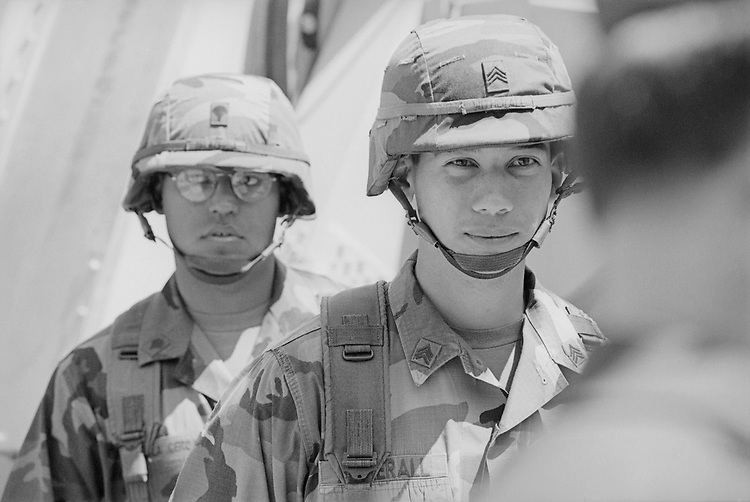 Army soldiers talking to each other during defense press briefing in April, 1998. (Photo by Rebecca Roth/CQ Roll Call via Getty Images)