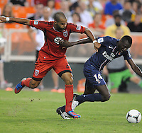 Pairs St Germain midfielder Blaise Matuidi (14) shields the ball from D.C. United forward Maicon Santos (29) D.C. United tied Paris St. Germain 1-1 at RFK Stadium, Saturday 28, 2012.