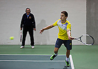 21-02-2014, Netherlands, Eemnes, Martin Simek, coach player without strings in racket<br /> Photo: Henk Koster
