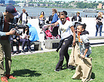 Deborah Koenigsberger and kids - potato sack race - Hearts of Gold 7th Annual Run/Walk for Kids with proceeds from this fun family event will change the futures of homeless mothers and their children on June 3, 2017 at Pier 84 Hudson Parks, New York City, New York. It supports Hearts of Gold Annual Back to School Programs. (Photo by Sue Coflin/Max Photos)