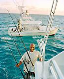 USA, Florida, mid adult man smiling on fishing boat at sea, portrait, Islamorada