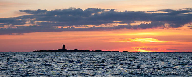 Segelskär Beacon is silhouetted against a Baltic Sea sunset in the outer archipelago near Tammisaari, Finland.