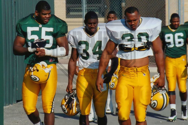 GREEN BAY - August 1997: Bernardo Harris (55), Edgar Bennett (34) and William Henderson (30) of the Green Bay Packers during a Training Camp practice in August, 1997 in Green Bay, Wisconsin. (Photo by Brad Krause)