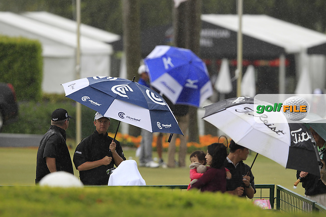 David Toms (USA) takes shelter as the heavens open in sunny Florida during Wednesday's Practice Day of the WGC Cadillac Championship at TPC Blue Monster, Doral Golf Resort & Spa, Miami Florida, 7th March 2012 (Photo Eoin Clarke/www.golffile.ie)