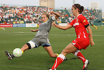 27 August 2011: Philadelphia's Nikki Krzysik (15) blocks a shot by Western New York's Alex Morgan (right). Western New York Flash defeated the Philadelphia Independence 5-4 on penalty kicks to win the final after the game ended in a 1-1 tie after overtime at Sahlen's Stadium in Rochester, New York in the Women's Professional Soccer championship game.
