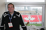 28 April 2007: Kansas City Wizards play by play announcer Sean Wheelock with a view of the East Stand and downtown Toronto behind him. Major League Soccer expansion team Toronto FC lost 1-0 to the Kansas City Wizards in the inaugural game at BMO Field in Toronto, Ontario, Canada, the first MLS game played outside of the United States.
