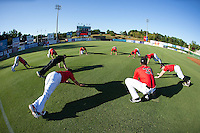The Kannapolis Intimidators stretch prior to their game against the Hickory Crawdads at CMC-Northeast Stadium on May 22, 2015 in Kannapolis, North Carolina.  The Intimidators defeated the Crawdads 4-3.  (Brian Westerholt/Four Seam Images)