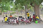 A class under the trees in the Loreto Primary School in Rumbek, South Sudan. The Loreto Sisters began a secondary school for girls in 2008, with students from throughout the country, but soon after added a primary in response to local community demands.<br /> <br /> The older girls leading the class are students of the Loreto Girls Secondary School. They took charge of the primary class so the regular teacher could attend a staff meeting.